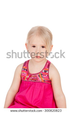 pretty little girl sitting in the folk dress