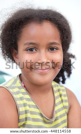 Pretty little girl smiling and looking at camera
