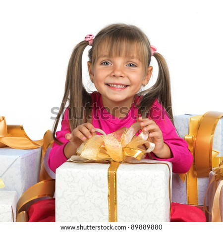 Pretty little girl smiling with present - stock photo