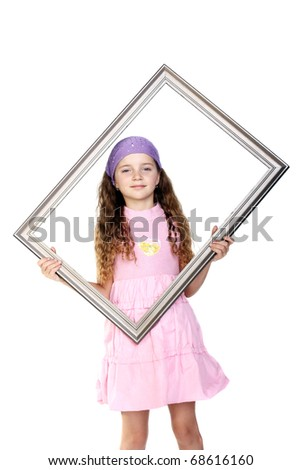 pretty little girl standing with the frame in her hands