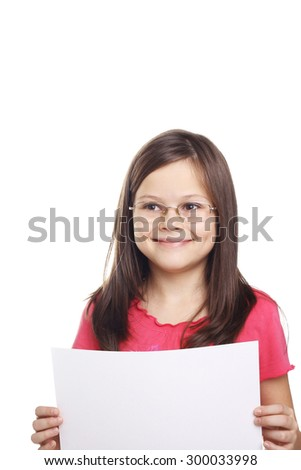 pretty little girl with a blank sheet of paper in her hands