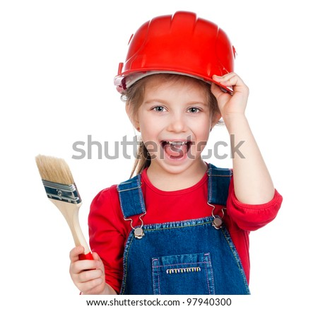Pretty little girl with a brush in a red helmet - stock photo