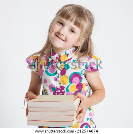 Pretty little girl with a stack of books, white background