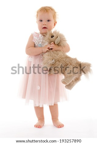 pretty little girl with a toy dog.isolated. - stock photo