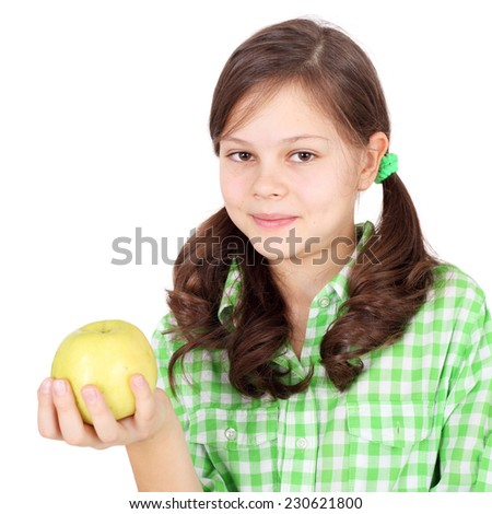 pretty little girl with an apple - stock photo