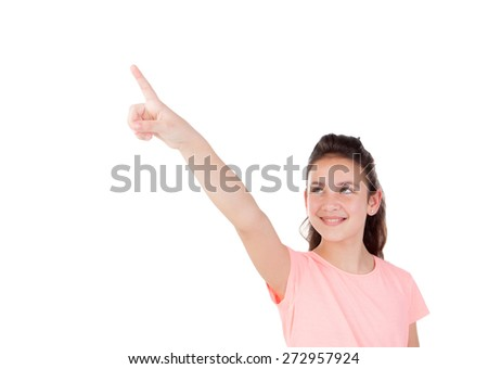 Pretty little girl with blue eyes indicating something with the finger isolated on a white background - stock photo