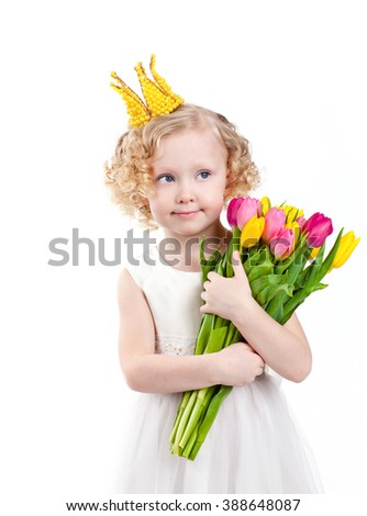 Pretty little girl with bouquet of colorful tulips