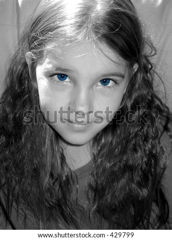 Pretty little girl with bright blue eyes.