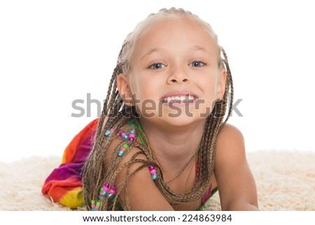 Pretty little girl with dreadlocks on the mat. Girl six years. - stock photo