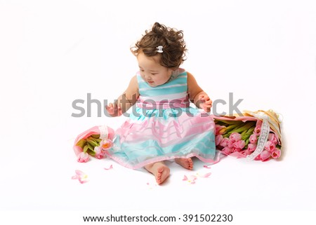 pretty little girl with flowers on white background isolated