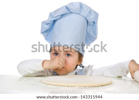 Pretty little girl with pizza dough over white background