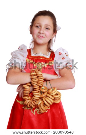 pretty little girl with round cracknel isolated over white background on Holiday theme/Nice young girl with lovely smile wearing traditional russian costume
