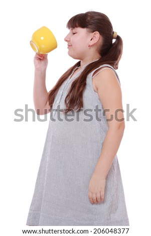 pretty little girl with tea cup isolated over white background