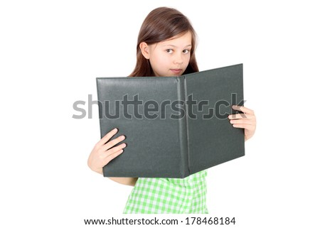 pretty little girl with the big green album - stock photo