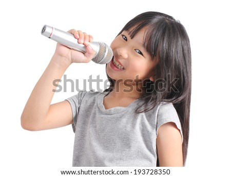 Pretty little girl with the microphone in her hand  - stock photo