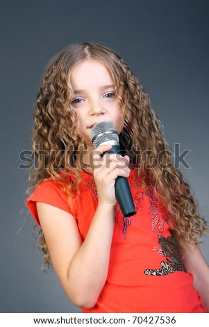 pretty little girl with the microphone in her hands