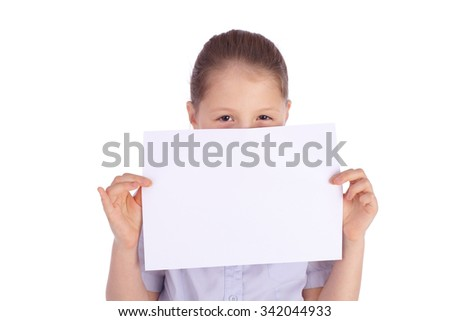 pretty little school girl holding blank sheet of paper