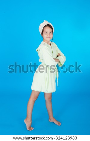 pretty little smiling girl in the bath robe