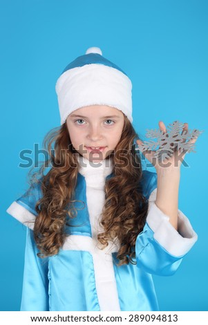 pretty little Snow Maiden with a snowflake in her hand