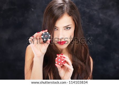 Pretty long hair woman holding chips for gambling - stock photo