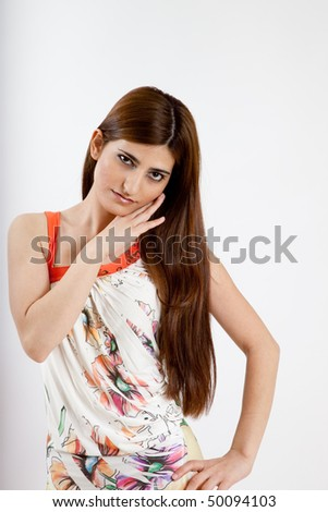 Pretty long haired woman with her hand on her hip