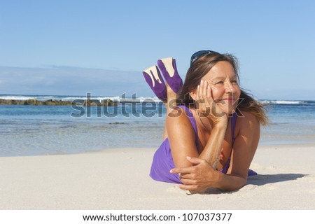 Pretty looking mature woman in sexy purple dress and high heel shoes at the  beach, - Rob Bayer's