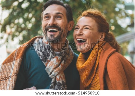Pretty loving couple expressing positive emotions