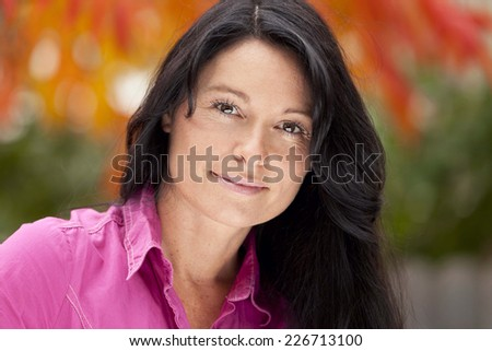 Pretty Mature Woman At The Park Smiling At The Camera  - stock photo