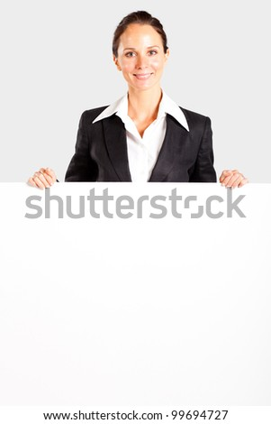 pretty mid age businesswoman behind white board