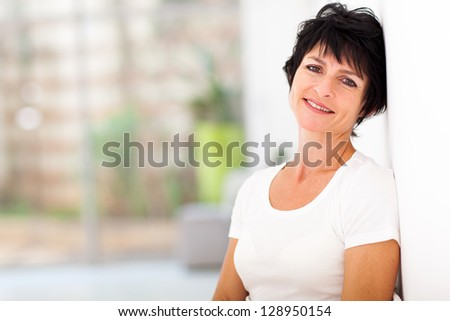 pretty mid age woman relaxing at home - stock photo