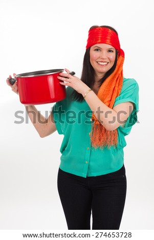 Pretty middle age woman wearing a colorful bandana holding a kitchen pot on a white background. - stock photo