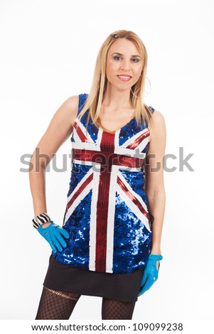 Pretty middle age woman wearing a sequin blouse with the British flag.