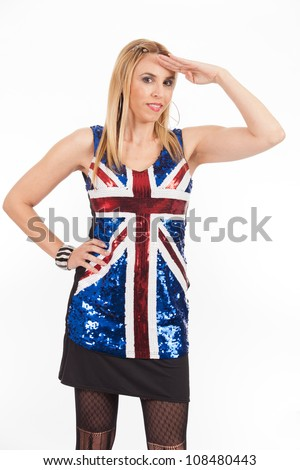 Pretty middle age woman wearing a sequin blouse with the British flag saluting.