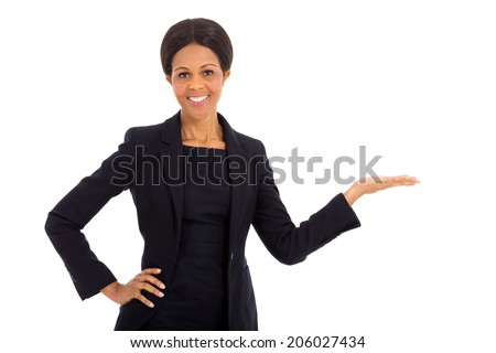 pretty middle aged african businesswoman presenting on white background - stock photo