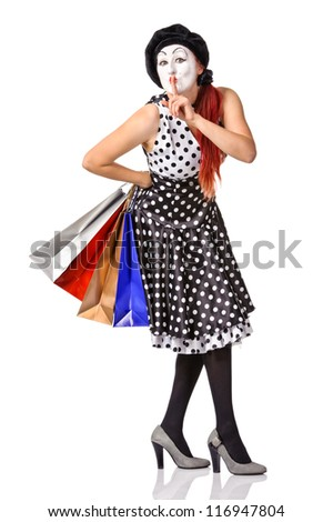Pretty mime in spotty dress holding shopping bags. Isolated - stock photo