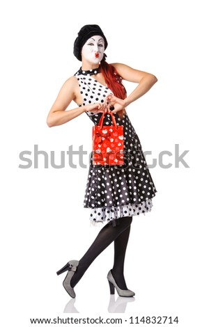 Pretty mime woman holding red shopping bag. Isolated on white background - stock photo