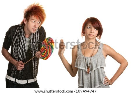 Pretty mixed race girl dismisses naive man with lollipop