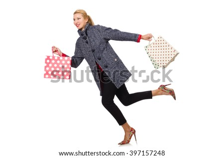 Pretty model in gray coat after shopping isolated on white - stock photo