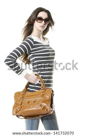 Pretty model in jeans with bag against white background - stock photo