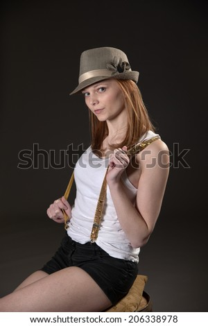 Pretty model with retro style hat - stock photo