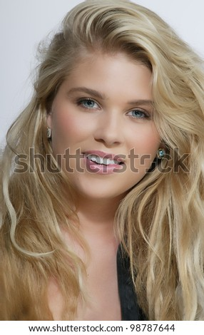 Pretty model with smile and long blond hair
