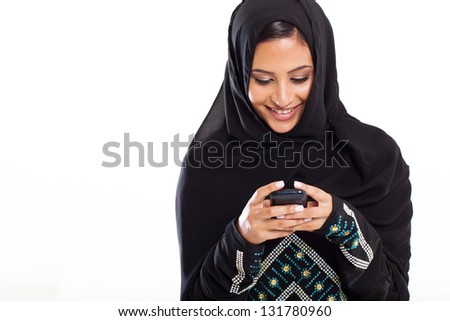pretty modern Arabic woman playing on smart phone isolated on white - stock photo