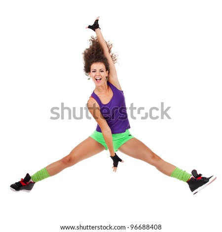 pretty modern slim hip-hop style woman dancer jumping and dancing isolated on a white studio background - stock photo