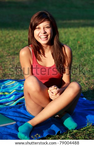Pretty multicultural college student at a university campus field. - stock photo