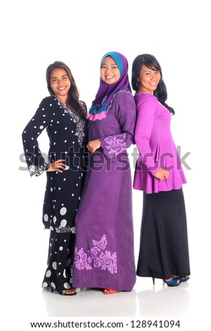 Pretty muslim woman model in action, on white background - stock photo