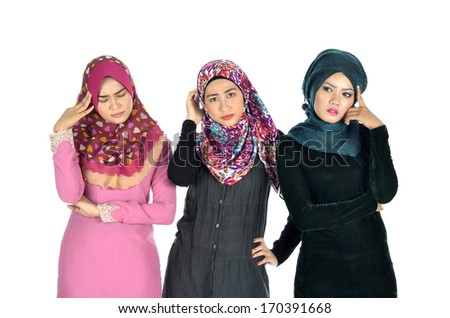 Pretty muslim woman model in stressed action, on white background - stock photo