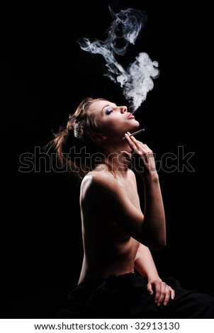 Pretty naked girl is smoking in dark