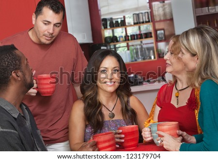 Pretty Native American female with group of people in cafe - stock photo