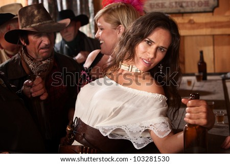Pretty Native American woman leaning back at a bar - stock photo