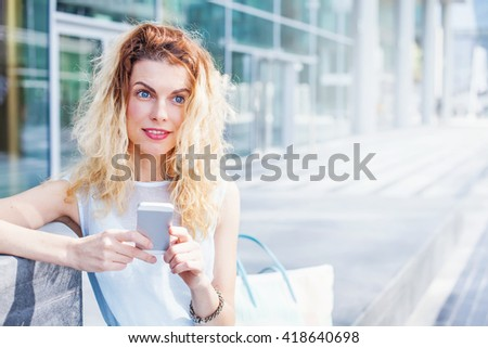 pretty natural young woman using app on her phone
